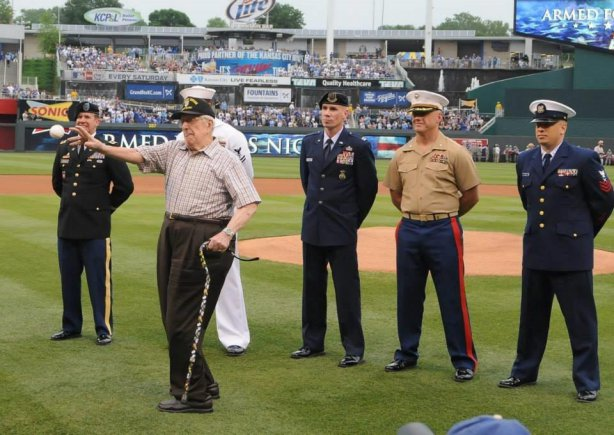 Ret. Col. Jack Brooks, a 3-war veteran who commanded a company on D-Day at Normandy Beach, France throws out the first pitch during an Armed Forces Pre-game Tribute at Kaufmann Stadium in Kansas City, Mo.